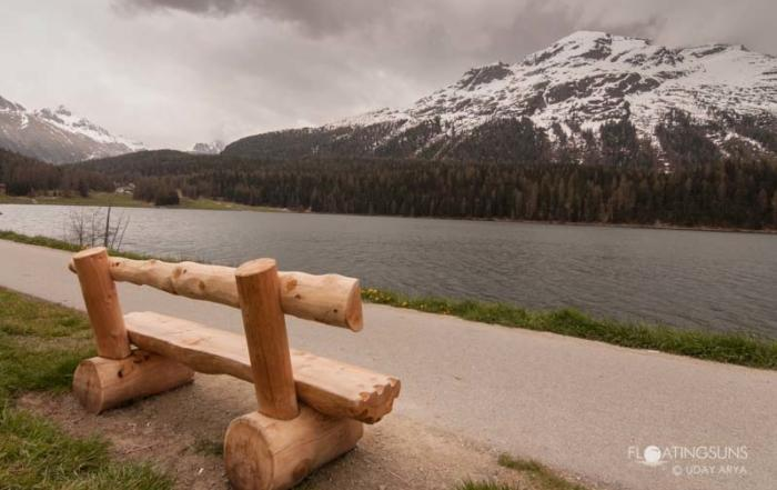 An inviting bench along the lake in St Moritz, against the backdrop of the beautiful Swiss alps covered in snow. The wind was biting but exhilirating!